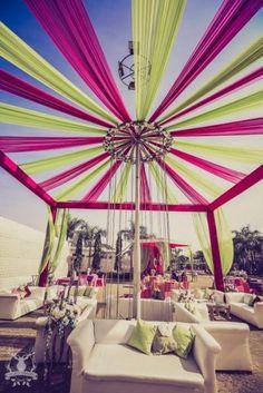Lime green and pink mehendi, drapes, day wedding, white seating, sofa seating,  chandelier, lime green cushions, funky mehendi, kitsch mehendi decor