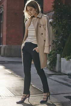 A classic khaki trench coat is always a great investment piece for your wardrobe. Create a modern look by styling it like Pamela Katz with a striped long-sleeved shirt, navy pinstripe pants and cobalt blue patent leather pumps | Banana Republic