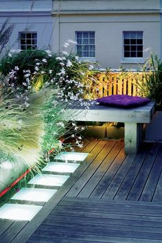 """Landscaping Roof Terraces Garden Design magazine:  This in London from garden designer Charlotte Rowe who always uses a """"simple palette of colors"""", here greens and pale pinks. She favors olive and juneberry trees that stand up to terrace environments, heat + cold; light fixtures that show dase the plantings;"""