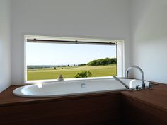 Bathroom Ideas: 12 Tubs with Amazing Views \\\ The idyllic pastoral view is reflected back in the simple bathroom interior, photographed by Swedish photographer Daniel Hertzell.