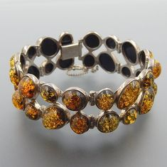 Fine Caribbean Wooden bracelet with big Natural Yellow amber Cab and little red amber cabs set in .925 Sterling Silver handmade.