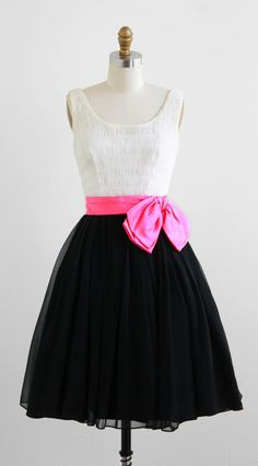 vintage 1960s party dress with hot pink bow.
