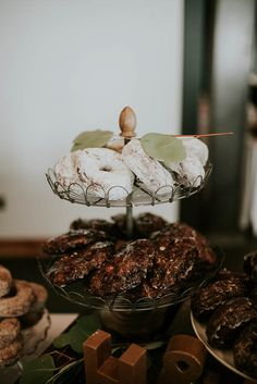 Powdered sugar and chocolate donuts | Image by Olivia Strohm Photography