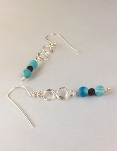 A personal favorite from my Etsy shop https://www.etsy.com/listing/260043207/aqua-dragon-fire-agate-earrings-infinity