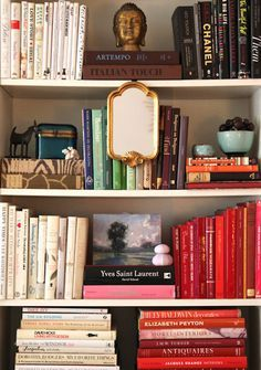 Group your books by light and dark (or white and colour) covers, arranging them on opposite sides of your shelf. Not only does it bring some order to your shelf, it makes a real statement.