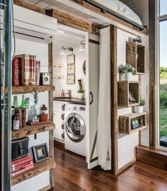The stand-out part of this tiny house might be its stunning pop-out deck, but it's not the only part of this home that's beautifully designed. Here's a closer look at the laundry room and some of the home's storage spaces (including a teeny tiny closet in front of that sliding door!). Click through for more design inspiration from this tiny house by New Frontier Tiny Homes.
