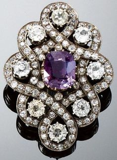 ALEXANDRITE BROOCH, LATE 19TH CENTURY. Set at the centre with a cushion-shaped alexandrite weighing 3.67 carats, within an interlacing surround of circular-cut diamonds and eight synthetic stones. #antique #Alexandrite #brooch