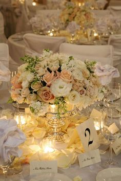 CENTERPIECES - how i want it to feel!! Totally gorgeous! Low round centerpiece with mercury glass vase, antique colored flowers, votives, petals