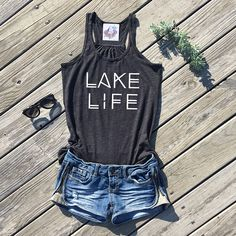 #ad lake life flowy racerback tank  flowy, lightweight racerback tank top poly/cotton blend = THE softest tank ever! perfect for summertime!  dark heather grey color  racerback tank top sizing: (below is approximate!)  XS: 0-2 S: 2-4 M: 6-10 L: 10-14 XL: 14-18    Purchase any two tank tops or t-shirts and get 15% off! Coupon code: BuyTwoGet15off   shirt for summer lake shirt for summer shirt for the lake summer wardrobe boho shirt