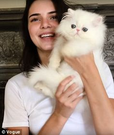 Uh-oh: She admits she is allergic to cats but doesn't care because this one is so cute