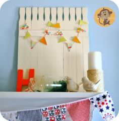 little mini picket fence out of paint sticks - how darling (& the little banner puts it over the top cute!)