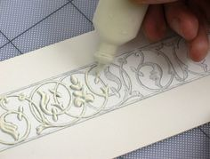 He uses polyfilla mixed with a bit of water for piping intricate designs. Dries in 2 hours.