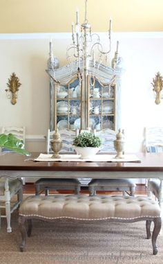 French Country dining room, painted furniture, antiques, upholstered bench, tufted bench, blue, toile, seagrass rug, vintage Ethan Allen sconces, fiddle leaf fig