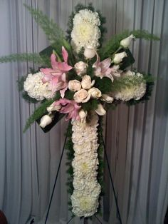 "Fantasy Flowers More ~ Pink White Sympathy Cross - Design is created on a 36"" Cross and composed of White Carnations, Roses, Pink Lilies, various foliage. Stand Included. $138.00"