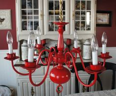 A spray painted old brass light fixture with scrapbook paper added ...