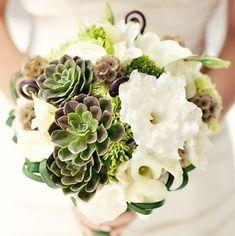 White flowers, succulents, scabiosa pods, fern shoots bouquet.