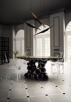 For large rooms, you have this extravagant and modern Newton Dining Table by Boca do Lobo so well combined with the Coltrane Suspension by Delightfull. A powerful dining room decoration.