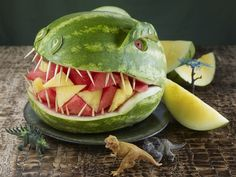 Throwing a dinosaur party? Your little excavators will roar over this prehistoric watermelon carving.  How to carve the Dinosaur watermelon.