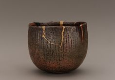 Raku ware tea bowl with gold lacquer repair, Edo period 1615-1868, Japan