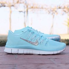 Customized pair of Nike Free 5.0 adorned with Swarovski rhinestones.  My niece wants a pair of these.