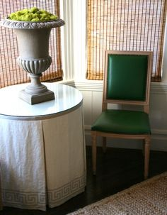 skirted table + green Louis chair. designer grant gibson