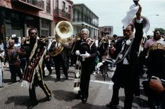"""""""When the Saints Go Marching In"""" has been adopted as the anthem of the city of New Orleans and is the fight song of its football team, The Saints, named in its honor. New Orleans Brass Band, New Orleans Art, American Hymn, The Kingston Trio, Second Line Parade, Carnival Dancers, Mahalia Jackson, Preservation Hall, Jazz Songs"""