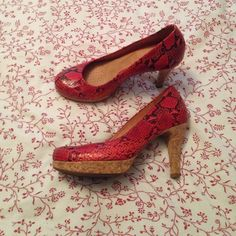 Red snakeskin pattern heels. Red snakeskin and cork heels. Padded insoles, perfect for walking or dancing. Worn twice. Heel height 4 inches. Nurture Shoes Heels
