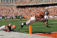 Brandon Tate #19 of the Cincinnati Bengals dives in to the endzone for a touchdown on a 44-yard pass reception as Eric Hagg #27 of the Cleveland Browns dives in vain in the third quarter at Paul Brown Stadium on September 16, 2012 in Cincinnati, Ohio.