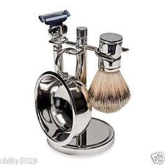 This is the perfect grooming accessory for any gentleman, this handsome 4-piece set includes a silver-plated stand, natural bristle shave brush, Mach III replaceable razor and silver-plated soap dish. - $48.50 SHOP TODAY!