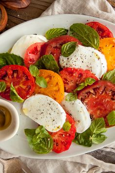 NYT Cooking: This classic summer dish doesn't get any simpler or more delicious. Use different-colored heirloom tomatoes for the prettiest salad, and buffalo milk mozzarella for the best tasting one.