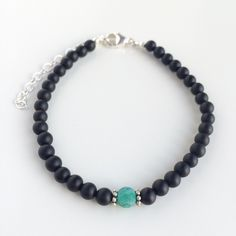 Handmade bracelet with genuine matte onyx and a green exotic frosted crackled fire agate gemstone bead, details in 925 sterling silver by Penello on Etsy https://www.etsy.com/listing/262885652/handmade-bracelet-with-genuine-matte