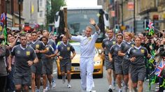 Triple Olympic champion Sir Chris Hoy carried the Olympic Flame through Manchester as part of the London 2012 Torch Relay on Olympic Day. (LOCOG) Add Around The Rings on www.Twitter.com/AroundTheRings & www.Facebook.com/AroundTheRings for the latest info on the #Olympics.