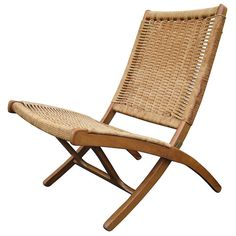 Woven Folding Chair in the Style of Hans Wegner | From a unique collection of antique and modern chairs at https://www.1stdibs.com/furniture/seating/chairs/