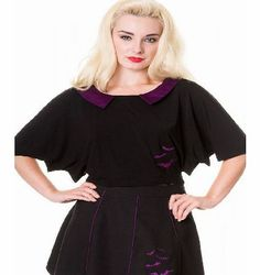 Banned Apparel Bat Top OBN-156 Black Womens oversized crop top Purple collar Bat wing sleeves Bat appliques on front Split back 95% Viscose, 5% Spandex http://www.comparestoreprices.co.uk/fashion-clothing/banned-apparel-bat-top-obn-156.asp