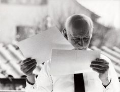 Otto Frank reading some letters from people who have read Anne's diary