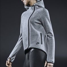 Nike side zip high low hooded cape jacket New message with questions! Wash in cold water and air dry so it won't shrink! Will lower with discounted shipping! Lowest price on poshmark! Nike Jackets & Coats