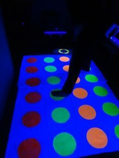 Use glow in the dark paint to make a glow in the dark twister! #glow #paint #glowparty