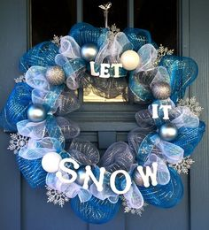 - Wire wreath frame covered with silver, blue and white mesh, silver shimmery snowflakes and blue and silver snowflake ribbon. - This wreath is decorated with matte blue, glittered silver and white or