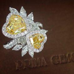 Bright like the sunshine: Natural Fancy Intense Yellow Heart Shape Diamond Ring from PrimaGems.