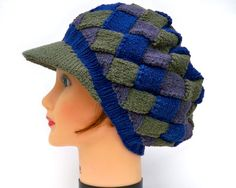 This unique, unisex newsboy cap was hand knit using the entrelac method. Entrelac is a knitting technique used to create a textured diamond