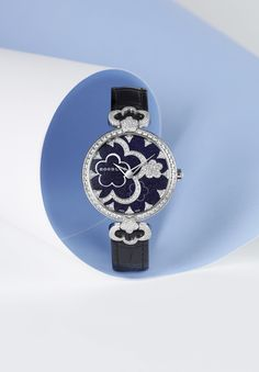 The Boodles Blossom Watch Handmade in Bienne, Switzerland, our first ever Boodles watch grew naturally from the Blossom collection. The blossom motif's layered like pressed flowers, with the petal-like lustre of Mother-of-Pearl finishing the remarkably feminine design. A marriage of British design and the finest Swiss watchmaking. Pictured: Boodles Full Bloom 'Blossom' Watch with blue aventurine dial and diamond-set details.