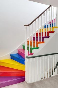 Colorful stairs:)Now I like this.Unique and different in home design