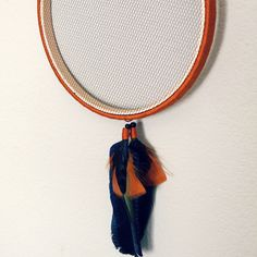 Amber Hoop Jewelry Organizer With Blue And Amber Feather Accent