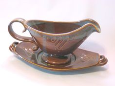 Serving Bowl / Boat and Saucer Set for Gravy orSauces by pottersong on etsy With rich rust brown and steel blue hues, this handmade gravy boat and matching saucer is a great addition for homey, yet elegant decor...that beautiful addition for the perfect kitchen and table setting.