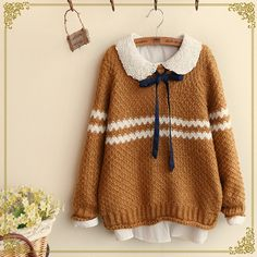 Estera would wear a tan sweater like this one. Japanese sweet striped sweater coat