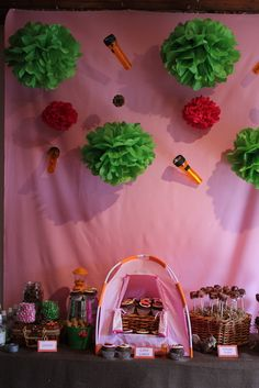 Love this backdrop with the hanging flashlights and the cupcakes in a tent