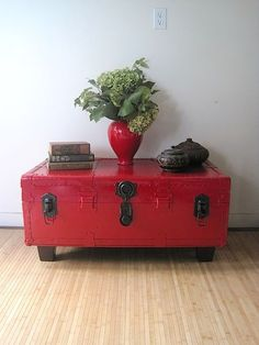 Repurposed painted metal trunk with legs = funky coffee table with storage.