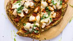 A better pizza crust, presented to you by the zucchini.. Ingredients:  4-6 zucchini, grated (to yield 4 cups), 1 tsp. kosher salt, 1/3 cup parmesan cheese, grated, 1/4 cup chickpea flour,  1/3 cup goat cheese, grated, 1 clove garlic, minced, 1 tsp. dried oregano, 1 tsp. dried basil, 1 egg, olive oil for greasing
