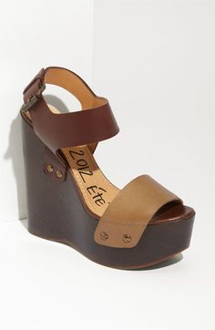 This wedge platform is great for skinny ankle jeans paired with a bohemian print top.
