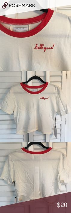 """NWT Kendall + Kylie Top Brand new Kendall + Kylie Crop Top Vintage Style Tee. Tan color with red neckline, and stitched """"hellyaas!"""" on the chest. Back features cute design that will show just a little skin 😉 Size L but can we worn as slightly oversized M or S. Kendall & Kylie Tops Crop Tops"""